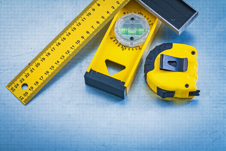 square ruler: Plastic tape measure wooden construction level and square ruler