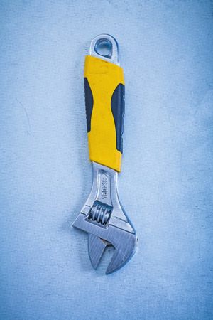 adjustable spanner: Stainless adjustable spanner on metallic background construction