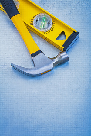claw hammer: Vertical view of construction level and claw hammer  Stock Photo