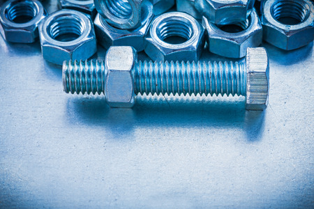threaded: Vertical view of threaded screw nuts and bolts
