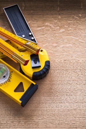 oaken: Wood oaken brown board with yellow units of measurement construction concept Stock Photo