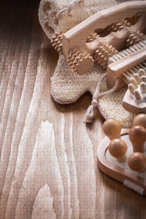 scrubbing: Pine vintage board with wooden massagers loofah scrubbing brush