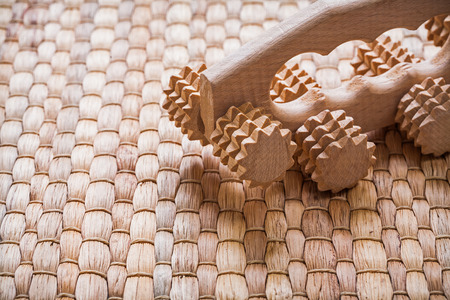 massager: Wooden relaxing massager on wicker background sauna concept Stock Photo