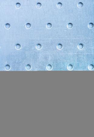drilled: Drilled stainless sheet construction concept. Stock Photo