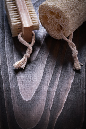 scrubbing: Vintage wooden board with scrubbing bath brush and loofah sauna concept