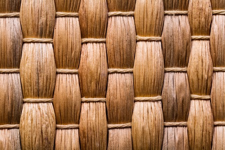 very close up view on natural bast wickered texture of mat.