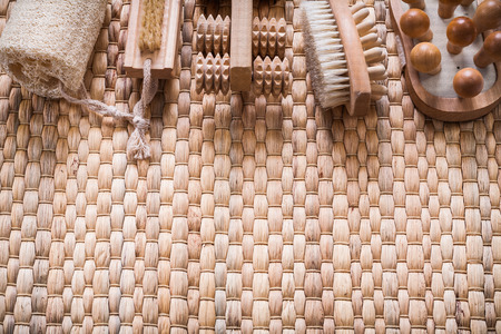 scrubbing: Scrubbing brush wooden massagers and loofah on wicker background healthcare concept
