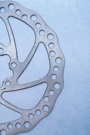 pinion: Metal pinion gear on flat metallic background machinery concept.