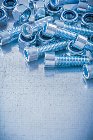 threaded: Group of threaded construction nuts and screw bolts on metallic background copy space image maintenance concept.