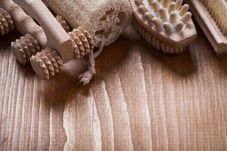 nail brush: Nail brush loofah and wooden massagers on pine vintage wood board sauna concept
