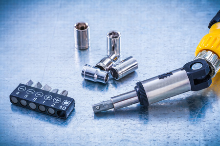 turnscrew: Set of reversive turnscrew screwdriver bits and torx on metallic background construction concept. Stock Photo