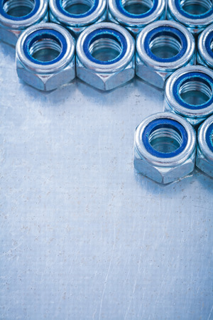 threaded: Threaded screw nuts on metallic background copy space image construction concept. Stock Photo