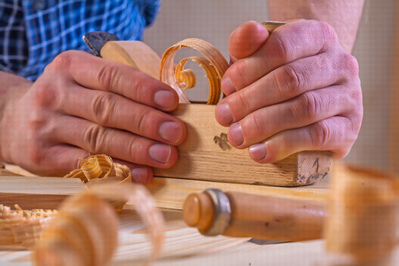 scobs: very close up view on work of joiner plane in hand. Stock Photo