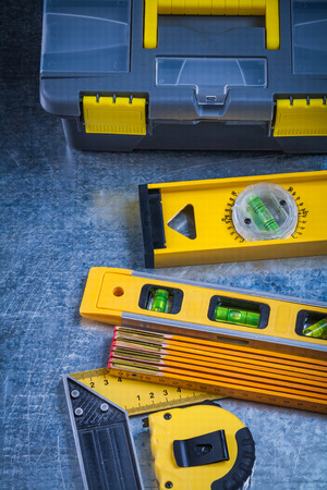 toolset: Toolbox construction levels and instruments of measurement on scratched metallic surface maintenance concept. Stock Photo