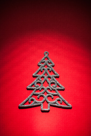 knack: christmas toy simbolf of fir tree on red background.