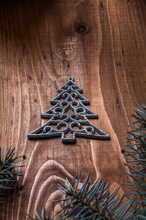 firtree: simbol of fir tree and branches of firtree on vintage wood board.
