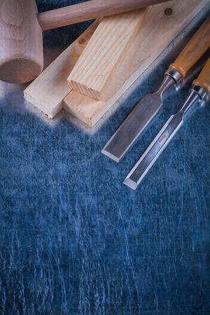 chisels: Wooden mallet bricks and flat chisels on scratched metallic surface construction concept. Stock Photo