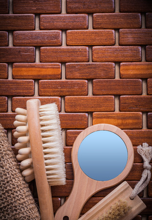 massager: Wood massager handglass body scrubber and peeling brush on textured wooden table mat sauna concept. Stock Photo