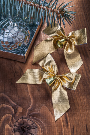 mirrorball: christmas baubles and bows fir tree on vintage wood board.