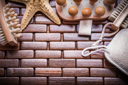a bathing place: Composition of bathing accessories on checked wooden place mat close up view sauna concept. Stock Photo