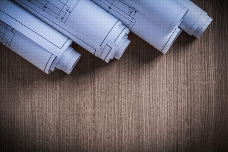 Pile of rolled construction plans architecture and building concept. Stock Photo