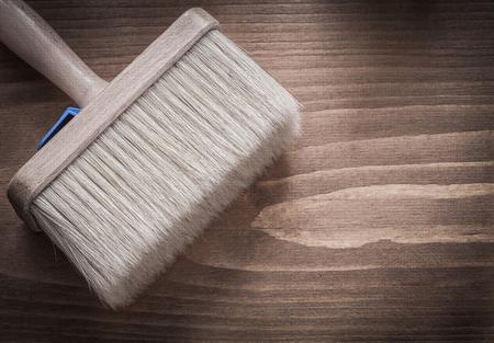 brocha de pintura: Paintbrush on wooden board construction concept.
