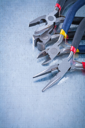 nippers: Insulated electric nippers on scratched metallic surface construction concept.