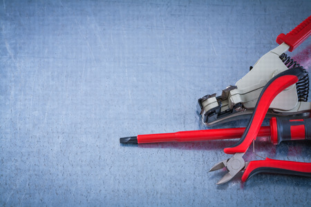 peeling rubber: Insulated screwdriver electricians tape automatic wire strippers construction concept. Stock Photo