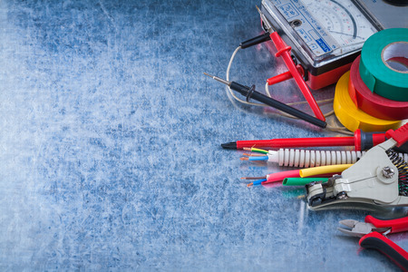 peeling rubber: Group of electrical equipment on metallic background horizontal view.