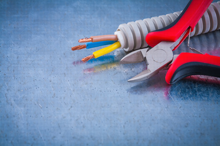 conduct: Electric conduct tubing copper cables and sharp wire cutters.