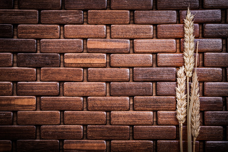 ear checked: Ripe wheat and rye ears on wooden mat horizontal version. Foto de archivo