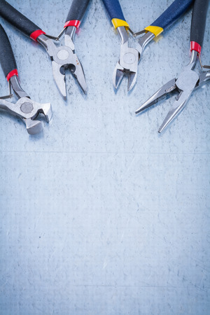nippers: Set of electric metal nippers on scratched metallic background copyspace. Stock Photo