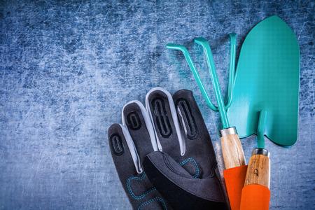 gardening gloves: Hand spade, metal rake and safety gardening gloves Stock Photo