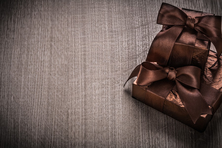 glittery: Gifts boxed in glittery paper with brown ribbons Stock Photo