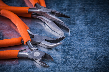 gripping: Collection of insulated cutting pliers gripping tongs with rubber handles. Stock Photo