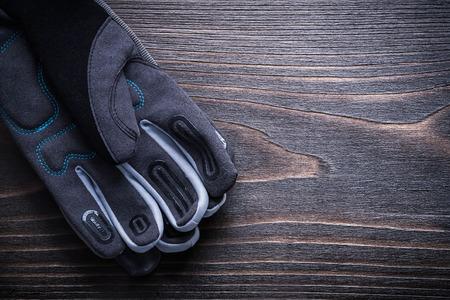 gardening gloves: Gardening gloves on vintage wooden board Stock Photo