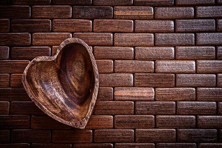backcloth: Heart shape bowl on wooden backcloth
