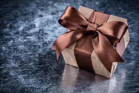 boxed: Boxed gift with present tape on metallic background Foto de archivo
