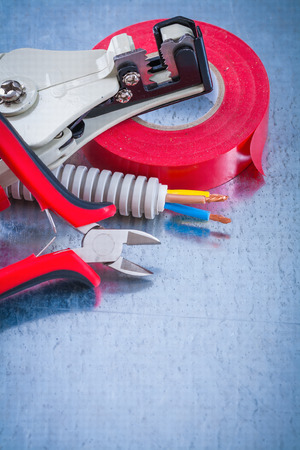 peeling rubber: Collection of electricians tape wire protection cables sharp nippers strippers.