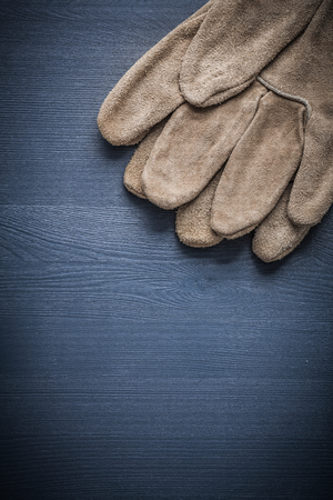 protective gloves: protective gloves on wood board.