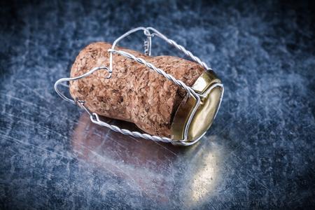 champagne cork: Champagne cork plugs twisted wire on metallic background