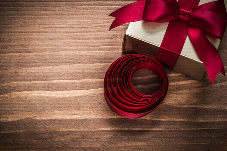 glittery: Glittery gold gift box rolled tape on vintage wooden board.