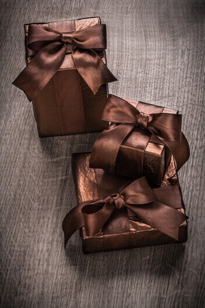 boxed: Presents boxed in glittery paper with brown ribbons Foto de archivo