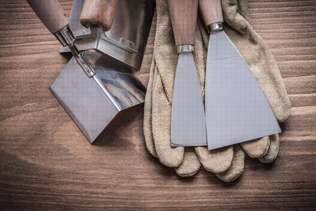 scrapers: angle surfacers, paint scrapers and glove. Stock Photo