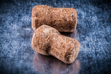 scratched: Champagne corks on scratched metallic background Stock Photo