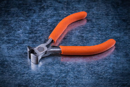 nippers: Insulated electric metal nippers on metallic background Stock Photo
