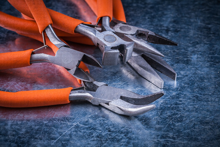 dielectric: Composition of insulated cutting pliers, gripping tongs with rubber handles.