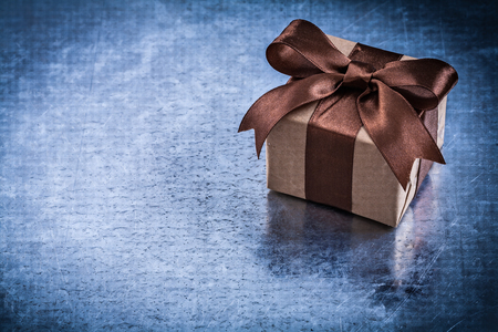 wrapped present: Wrapped present box with brown ribbon Stock Photo