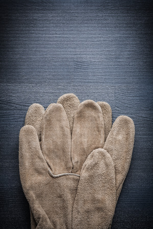 working gloves: safety working gloves on dark board.