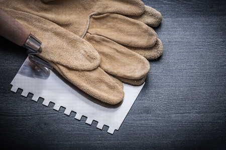 patching: pair gloves steel putty knife. Stock Photo